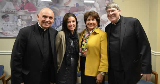 Left to Right: Father Dorsonville, Roxana Olivas (Director of the Office on Latino Affairs), Janet Murguía (NCLR President and CEO) and Monsignor Enzler